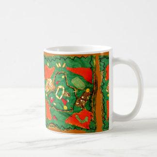 El paño y la gota diseñan en la taza del café/del