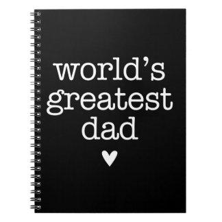 El papá más grande del mundo con el cuaderno de Sp
