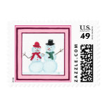 El par feliz en marco rosado, navidad de la nieve