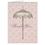 El paraguas rosado del parasol del vintage le agra felicitacion