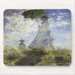 El paseo, señora con un parasol alfombrillas de ratones