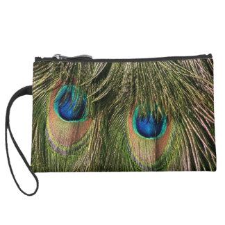 El pavo real bonito empluma el monedero del bolso