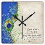 El pavo real empluma escritura real del cristiano  relojes de pared