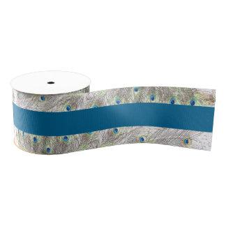 El pavo real empluma la cinta grosgrain azul