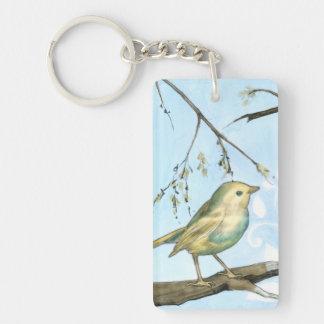 El pequeño pájaro amarillo se encaramó en una rama llavero rectangular acrílico a doble cara