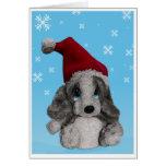 El perrito lindo en navidad del gorra de Santa le  Felicitaciones