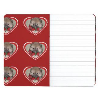 El perrito pomeranian de la tarjeta del día de San Cuaderno