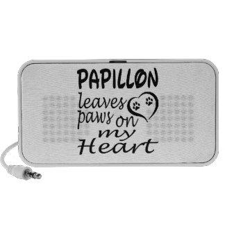 El perro de Papillon deja la pata en mi corazón