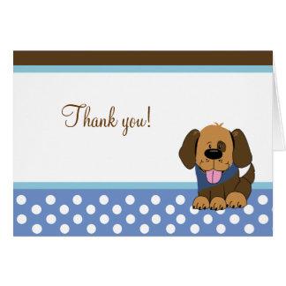 El perro de perrito hermoso de Brown doblado le ag Felicitaciones