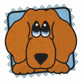 El perro de perrito observa el Dachshund
