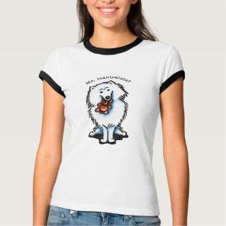 El perro esquimal americano manipula remeras
