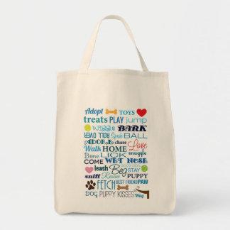El perro redacta el bolso bolsa tela para la compra