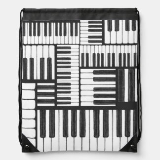 El piano cierra el bolso blanco y negro mochila