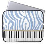 El piano cierra el estampado de zebra del azul de  mangas portátiles