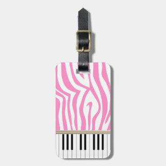 El piano cierra el estampado de zebra rosado etiquetas de maletas