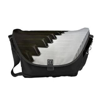 El piano cierra la bolsa de mensajero del amante d bolsas de mensajeria