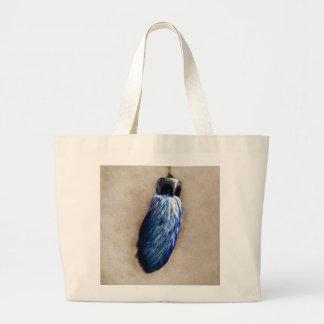 El pie de conejo afortunado azul bolsas de mano