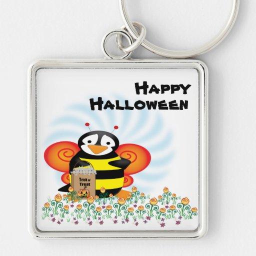 El pingüino de Halloween manosea llavero de la abe