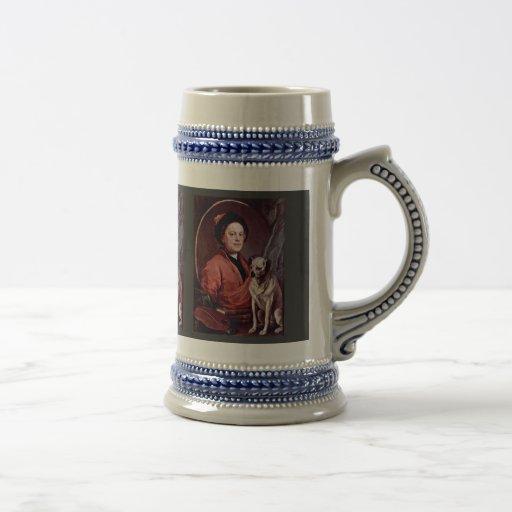 El pintor y su autorretrato del barro amasado por  taza