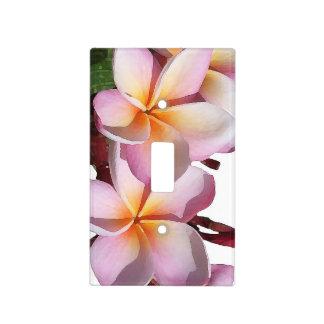 El Plumeria florece la cubierta de interruptor de