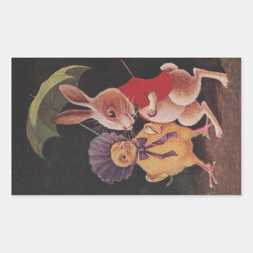 El polluelo con el paraguas camina con el conejo pegatina rectangular
