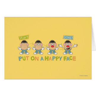 El poner en una cara feliz tarjeta de felicitación
