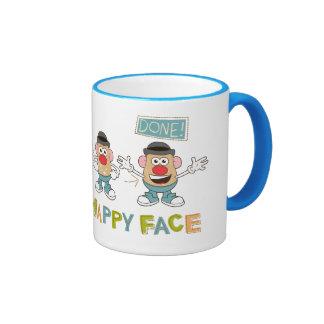 El poner en una cara feliz taza de dos colores