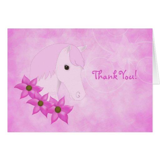 El potro y las flores rosados le agradecen cardar tarjetas