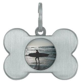 El practicar surf de la puesta del sol placas mascota