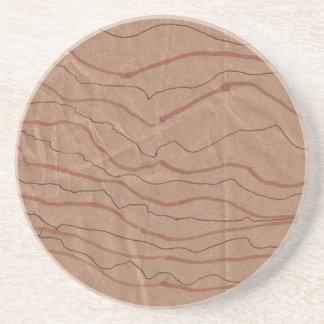 El práctico de costa de la piedra arenisca con posavasos de arenisca