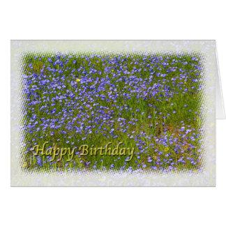 El prado azul y amarillo florece feliz cumpleaños tarjeta de felicitación