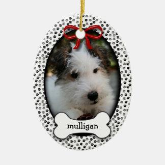 El primer navidad del perrito adorno navideño ovalado de cerámica