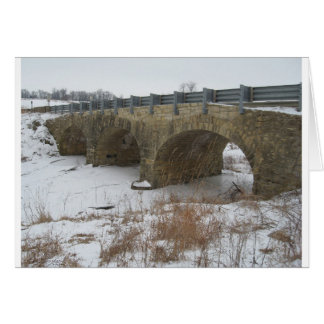 El puente de piedra histórico de Ely Felicitaciones