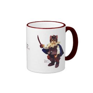 El Puss N patea la taza cobrable del gato de Tyber