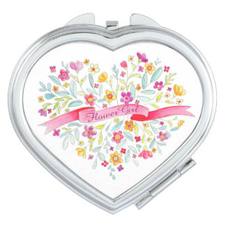 El ramo del corazón del florista florece el espejo espejos maquillaje