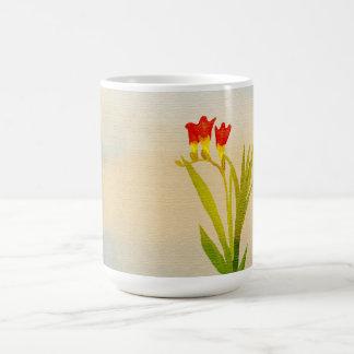 el ramo rojo hermoso florece la taza