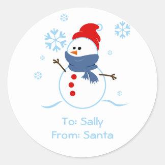 El regalo del muñeco de nieve marca al pegatina co