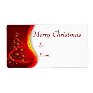 El regalo del navidad marca el árbol con etiqueta etiqueta de envío