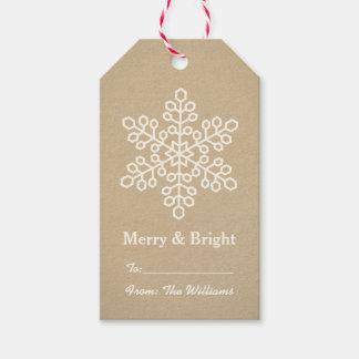 El regalo feliz y brillante marca el copo de nieve etiquetas para regalos
