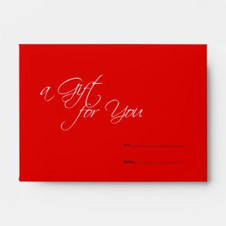 El regalo rojo de la tienda del negocio para usted sobres