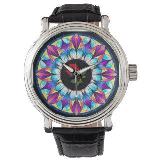 el reloj con diseño del molinillo de viento y el