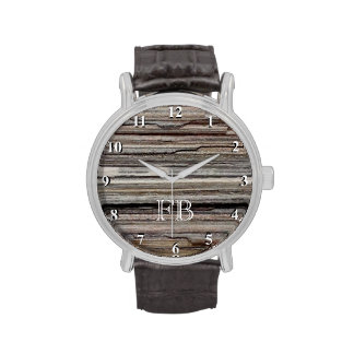El reloj de los hombres con clase con el monograma