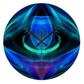 El reloj de pared del extracto de la llama azul
