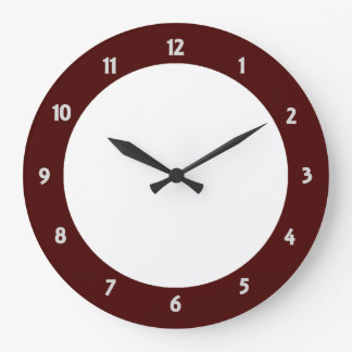 El reloj de pared redondo de la franja roja crea