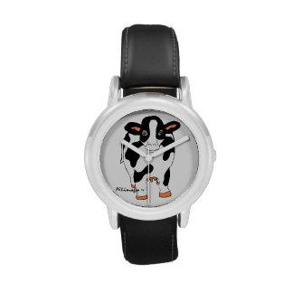 El reloj del niño blanco y negro de la vaca