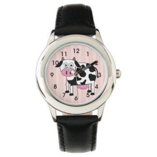 El reloj del niño divertido de la vaca
