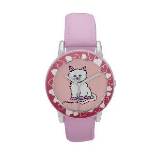 El reloj rosado de las patas del niño rosado del g