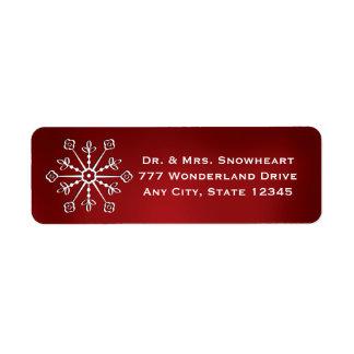 El remite del copo de nieve rojo etiqueta a los pe etiquetas de remite