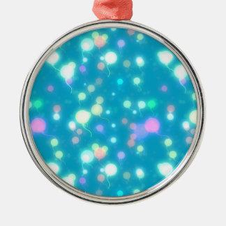 El resplandor ligero hincha diseño azul brillante adorno navideño redondo de metal
