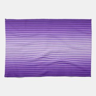 El resplandor púrpura raya las toallas de cocina d